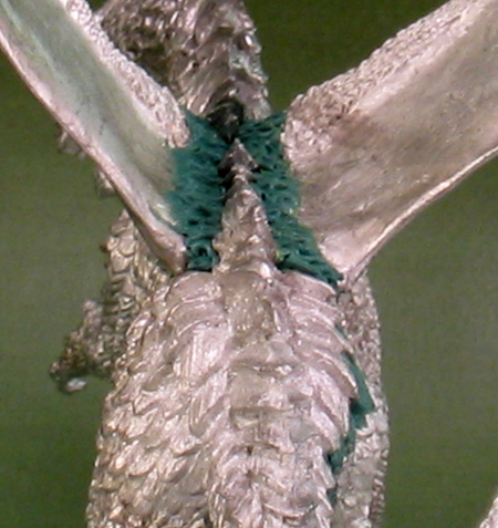 Sculpted scales on the spine of 'Deathsleet'