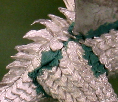 Sculpted scales on the thigh of 'Deathsleet'